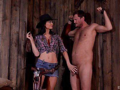 BDSM fetish lover Jasmine Jae dressed as a cowboy humiliates her slave