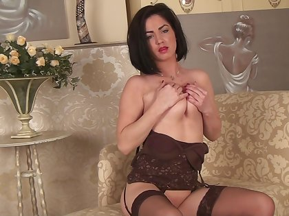 Naughty mature Crystall Anne moans while pigeon-holing her pussy